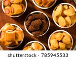 mixed brazilian snack on the... | Shutterstock . vector #785945533