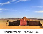 Small photo of Nomad tents made of camel skin in the middle of the desert with mountains in the background