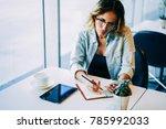 young pondering businesswoman... | Shutterstock . vector #785992033