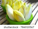 basket of white belgian endives ...   Shutterstock . vector #786010567