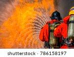 firefighter in fire fighting... | Shutterstock . vector #786158197