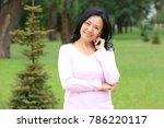beautiful mature woman outdoors | Shutterstock . vector #786220117