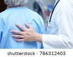 Small photo of Doctor Touching to support Asian senior or elderly old lady woman patient with love, care, encourage and empathy at nursing hospital