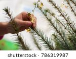 Small photo of hand adorn Christmas tree decoration of gold color