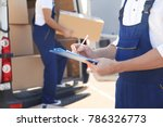 delivery man checking list on... | Shutterstock . vector #786326773