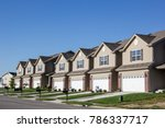 Small photo of Illinois, United States - circa 2014 - New Residential Attached Row Housing Subdivision Development with garages and small yards and driveways