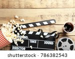 Tasty popcorn  clapboard and...