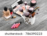 makeup items on table.... | Shutterstock . vector #786390223