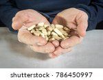 pills in hand. medicine and... | Shutterstock . vector #786450997