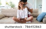 man giving massage to his wife | Shutterstock . vector #786452863