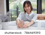 woman sitting at dining table...   Shutterstock . vector #786469393