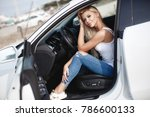sexy young blonde woman in car. ...   Shutterstock . vector #786600133