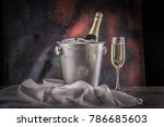 glass of champagne with bottle... | Shutterstock . vector #786685603