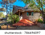 Hotel in Africa. Kenya. Accommodation in Kenya. Bungalow with a roof of a creeper. Buildings in the African style.