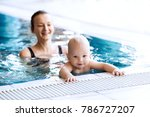 mother teaching baby to swim.... | Shutterstock . vector #786727207