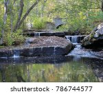 Beautiful small forest waterfall in Purgatory Chasm Park in Massachusetts