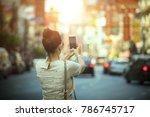 woman tourist taking a... | Shutterstock . vector #786745717