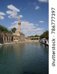 Small photo of URFA, TURKEY - JUN 7, 2014 - Halil Rahman Cami on Birket Ibrahim ( the pool of Abraham) in Sanliurfa, Turkey