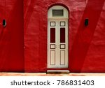 Old Arched Door Set In A Bold...