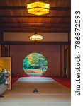 Small photo of NOVEMBER 23, 2017. KAMAKURA, JAPAN. Ikebana Flower arrangement and a famous Round Window inside the Meigetsu-in temple of the Rinzai Zen Sect founded in 1160.