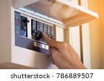 the electrician on hand open... | Shutterstock . vector #786889507