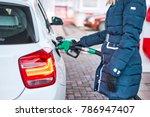 girl in jacket fills petrol... | Shutterstock . vector #786947407