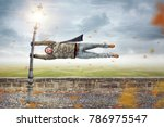 man holding on to a street lamp ... | Shutterstock . vector #786975547