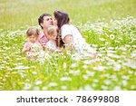 happy family having fun outdoors   Shutterstock . vector #78699808