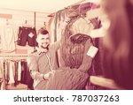 smiling guy deciding on new... | Shutterstock . vector #787037263