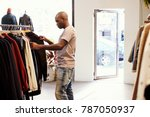 young black man browsing... | Shutterstock . vector #787050937