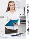 Small photo of Woman is signing profitable financial agreement in office.