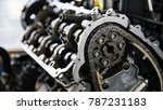 Small photo of Close-up of an open engine block and crankshaft on a table in service garage. Automotive part,machine part .