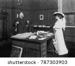 Small photo of Scene from the play, THE HIGH ROAD, by Edward Sheldon, performed on Broadway in 1912. The heroine, played by Minnie Maddern Fiske bravely confronts her scandalous past and resists blackmail that will