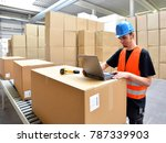 Small photo of logistics worker - man scans parcels of goods and prepares the dispatch in a company's department store
