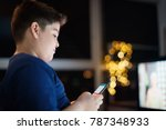 Small photo of Young people and youth problems. Preteen kid left alone at home, sends text messages with phone to friends. Concept of potential victim of cyber bulling and absence of parental control