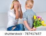 Son Holds Behind His Bouquet O...