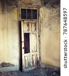 Small photo of rustic door in an abounded house