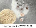 shredded thin dough with sieve... | Shutterstock . vector #787695127