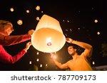 two people releasing a... | Shutterstock . vector #787709173