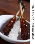 Small photo of brown and white rock candy, rock candy, rock sugar on wood stick, crystal sugar on stick, sugar candy, rock candy