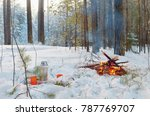campfire burns in the snow in... | Shutterstock . vector #787769707