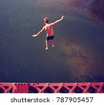 a boy jumping of an old train... | Shutterstock . vector #787905457
