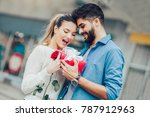 romantic man giving flower and... | Shutterstock . vector #787912963