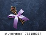 golden key with rose ribbon on... | Shutterstock . vector #788188387