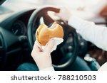 man eating an hamburger and... | Shutterstock . vector #788210503