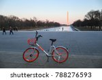 Small photo of Washington, DC - January 6, 2018: A Mobike, a bike part of a fully station-less bicycle-sharing system headquartered in Beijing, China, is parked outside of the Lincoln Memorial.