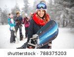 female snowboarder hold... | Shutterstock . vector #788375203