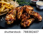 kentucky wings and french fries | Shutterstock . vector #788382607