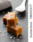 Small photo of Hand made caramel toffee pieces with sea salt on kitchen stone plate background