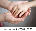 mother holding baby hand | Shutterstock . vector #788416273